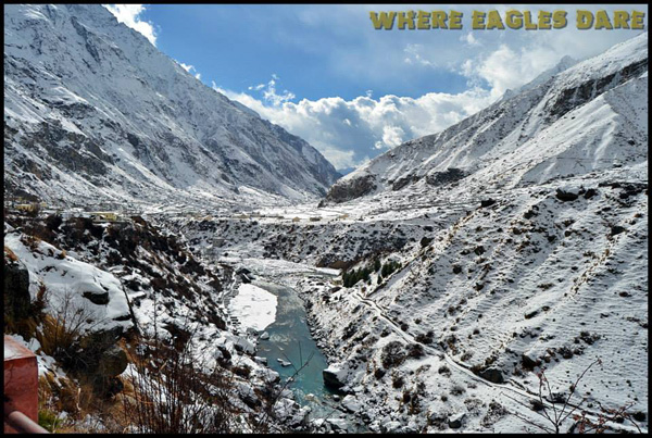 The majestic view of Badrinath Town covered with snow from Mana Village